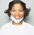 African female dentist smiling