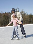 African father and daughter ice skating