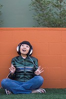 Asian woman listening to headphones