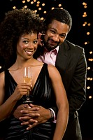 Portrait of African couple with champagne