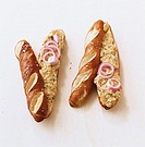 Two pretzel sticks with goat's cheese spread