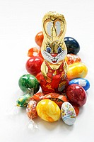 Easter Bunny surrounded by sweets and coloured eggs
