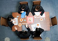 High angle view of five business executives in a meeting