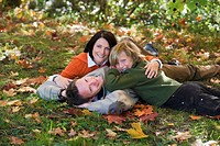 Parents with son lying in meadow