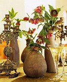 Lenten roses, white wine and antique candlestick