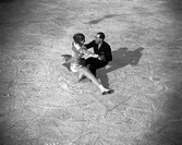 Couple ice-skating, c 1930s