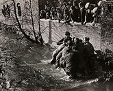 A photograph of players fighting for the ball in Henmore Brook during the Shrovetide football match in Ashbourne, Derbyshire, in 1950  Shrovetide foot...