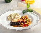 Carp cutlet with peppers and rice