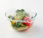 Bowl of vegetables covered with clingfilm