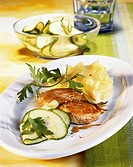 Pork escalope with mashed potato and courgette salad