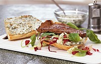 Steak sandwich with herb ricotta and salad