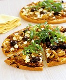 Pizza with goat´s cheese, onions and olives