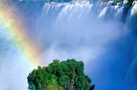 Rainbow over Iguazu Waterfalls in Parque Nacional Iguazu viewed from Upper Circuit, border of Brazil and Argentina