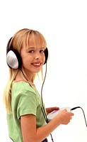 Young girl wearing large ear phones