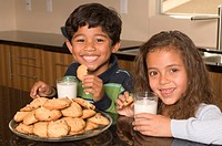Portrait of Hispanic boy and girl with cookies