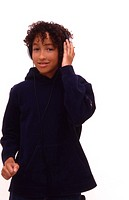 Young boy listening to music on large earphones