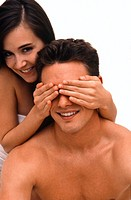 Woman covering Man's eyes with hands