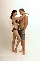 Portrait of a couple flirting with each other in bathing suits