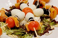 Salad with quail eggs and fresh vegetables
