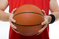 Man holding basketball (thumbnail)