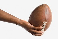 Man holding american football (thumbnail)