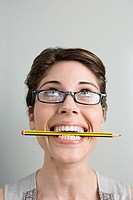 Woman with pencil in her mouth