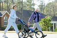 Women Walking with Baby Stroller