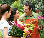 Florist Helping Customers Select Flowers