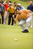 Excited Golfer Making Shot