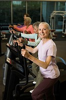 Women Exercising on an Elliptical Trainer (thumbnail)