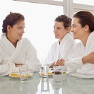 Three Women in Bathrobes at Table