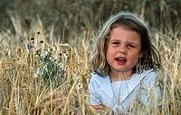 Little girl in grain field. Bornholm. Denmark