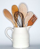 Close-up of wire whisks, fork and wooden spoons