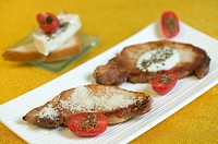 Pork cutlets with Parmesan and basil light cream