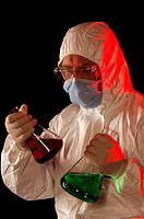 Technician mixing two chemical substances liquid