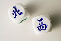 Still life of Chinese dice with the words 'North' and 'West'