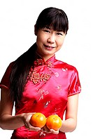 Woman in Cheongsam, holding two oranges