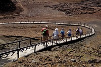 TOURISTS ON TRAIL Bartolome Island, Galapagos Islands, Pacific Ocean