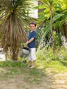 Boy watering the lawn