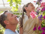 Father and daughter looking at a hanging basket