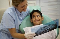 Dentist showing young patient his x-rays