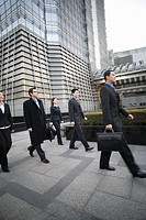 Businesspeople walking outdoors