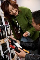 Couple choosing wine