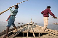 Boatmen transporting pilgrims to Sangam, the place where the Yamuna meets the Ganges, the holiest of places to take a bath
