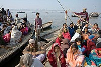 Pilgrims on boats to reach Sangam,  the meetingg point of the Yamuna river and the Ganges river, the holiest place where to bath during the Ardh Khumb...