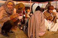 Pilgrims arriving late at  the Nirvani Akhara drinking 'Chai' to get warm