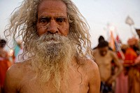 Holy man coming out of the sacred Ganges after the big bath during the ardh khumbh mela