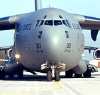 An Airman marshals a C-17 Globemaster III as it begins a mission from Ramstein Air Base, Germany, on Sunday, March 19, 2006. The Mississippi Air Natio...