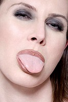 Young woman, portrait, tongue out