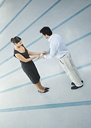 Woman and man exchanging business card, full length, high angle view